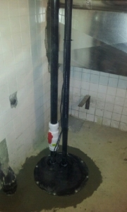 Sewage pump installation in basement